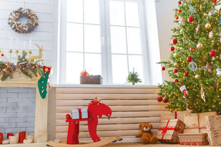 Merry Christmas and Happy New Year! Interior of room decorated for holidays.