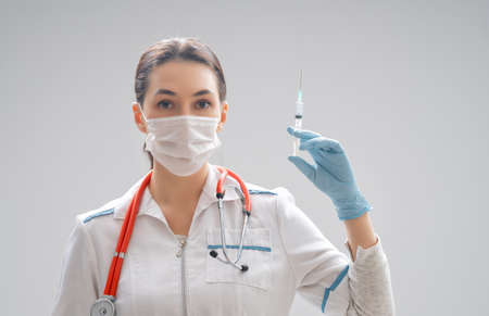 Medical doctor or laborant holding injection vaccine. Concept of Covid-19 treatment and prevention.