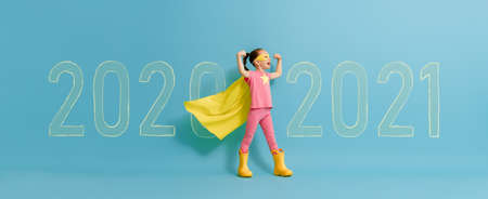 Child in superhero costume between 2020 and 2021 years on background of wall. Imagens - 161898323