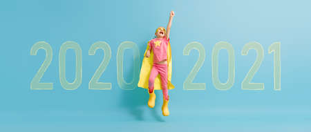 Child in superhero costume between 2020 and 2021 years on background of wall. Imagens - 161898332