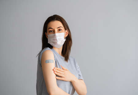 Young woman after vaccination. Virus protection. COVID-2019.