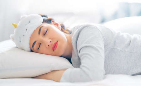 Beautiful young woman is sleeping in the bedroom at home.