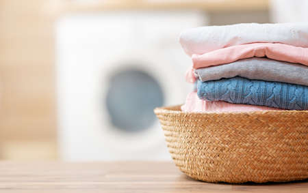 clothes in the basket in the laundry room