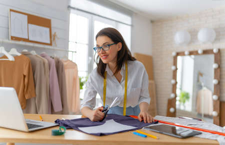 Woman is working at workshop. Concept of small business.