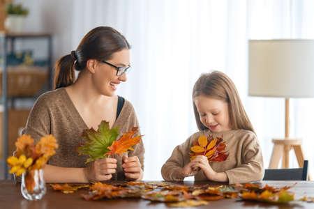 Happy family doing autumn decor. Fall atmosphere