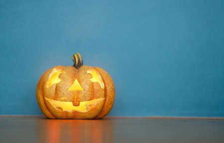 Happy halloween! Pumpkin on blue background.