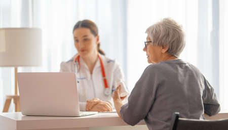 Female patient listening to a doctor in hospital.