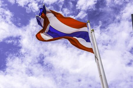 Waving  flag of Thailand with blue sky