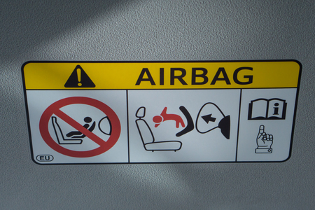 inflated: Air bag sticker label in car