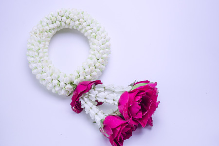 Fresh flower garland used on Mother`s Day and Songkran day in Thai tradition on isolate white background.