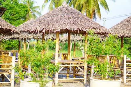 Seat with thatched roof at Thailand in Asia. 版權商用圖片 - 122825079