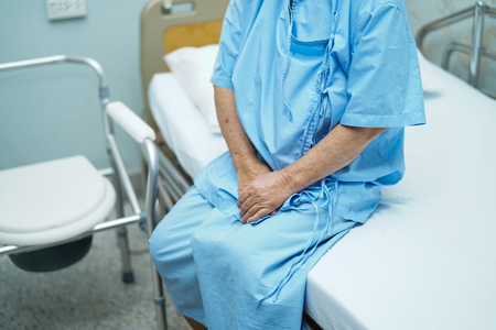 Asian senior or elderly old lady woman patient smile bright face while sitting on bed in nursing hospital ward : healthy strong medical concept 写真素材 - 122825114
