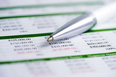 Spreadsheet table paper with pen. Finance development, Banking Account, Statistics Investment Analytic research data economy, trading, Mobile office reporting Business company meeting concept.