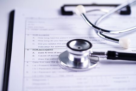 Health insurance accident claim form with stethoscope, Medical concept.