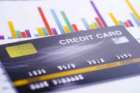 Credit card model on chart and graph spreadsheet paper. Finance development, Banking Account, Statistics, Investment Analytic research data economy, Stock exchange trading, Business company concept.