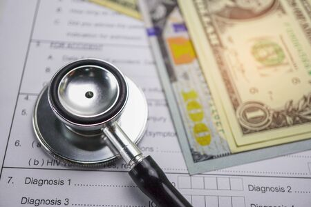 Health insurance accident claim form with stethoscope and US dollar banknotes, Medical concept. Banque d'images
