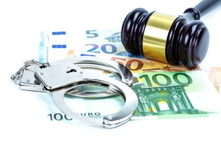 Metal handcuffs and mobile phone on chart graph background. Hacker economy finance banking static concept.