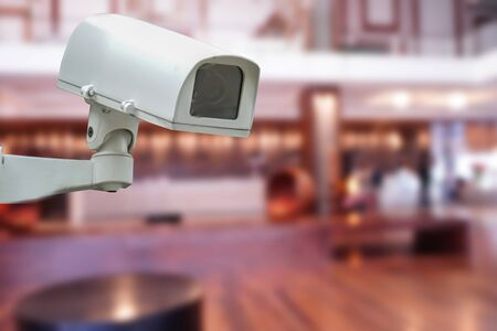 CCTV Closed circuit camera, TV monitoring at modern lobby hotel building construction : security system concept.