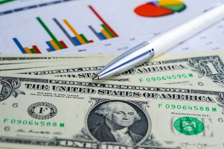 US dollar banknotes money on chart graph spreadsheet paper. Financial development, Banking Account, Statistics, Investment Analytic research data economy, trading, office reporting Business company meeting concept.