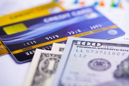 Credit card model with US dollar banknotes : Financial development, Accounting, Statistics, Investment Analytic research data economy office Business company banking concept. Фото со стока