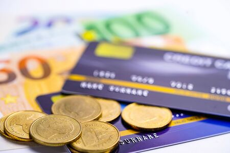 Credit card model with coins and Euro banknotes : Financial development, Accounting, Statistics, Investment Analytic research data economy office Business company banking concept.