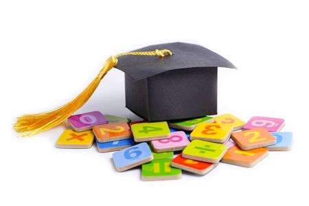 Math Number colorful with graduation gap hat on white background, Education study mathematics learning teach concept. Zdjęcie Seryjne - 130781231