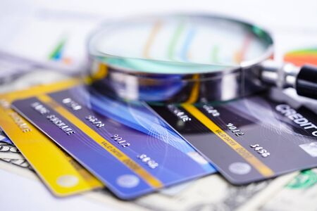 Credit card model with Magnifying glass : Financial development, Accounting, Statistics, Investment Analytic research data economy office Business company banking concept.
