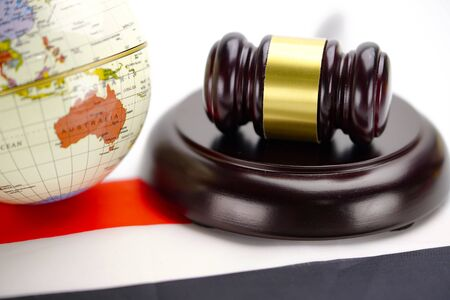 Judge hammer on wold globe map. Law and justice court concept.