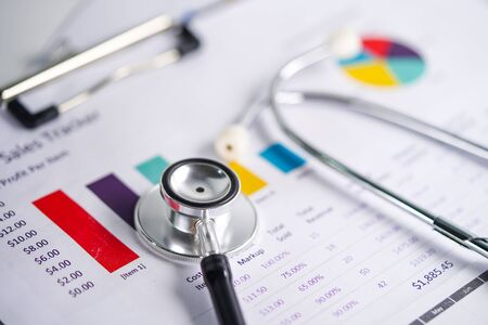 Stethoscope, Charts and Graphs spreadsheet paper, Finance, Account, Statistics, Investment, Analytic research data economy spreadsheet and Business company concept.