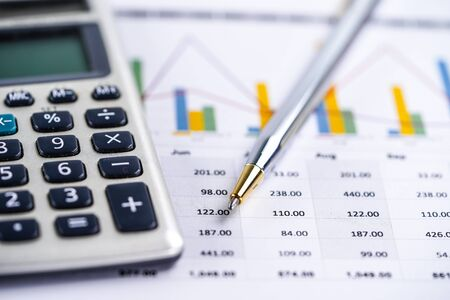 Calculator on chart and graph spreadsheet paper. Finance development, Banking Account, Statistics, Investment Analytic research data economy, Stock exchange trading, Business company concept.