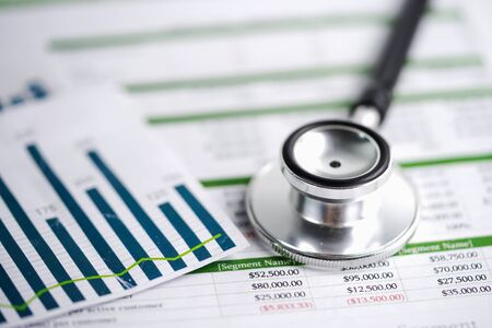 Stethoscope on spreadsheet paper, Finance, Account, Statistics, Investment, Analytic research data economy spreadsheet and Business company concept. Banco de Imagens