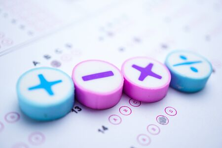 Math symbol and pencil on Answer sheet background : Education study mathematics learning teach concept. Stock Photo