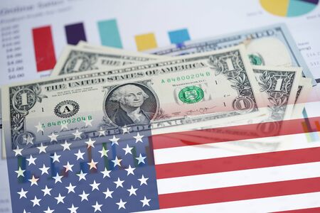 US dollar banknotes money on chart graph spreadsheet paper with USA America Flag. Financial development, Banking Account, Statistics, Investment Analytic research data economy, trading, office reporting Business company meeting concept.