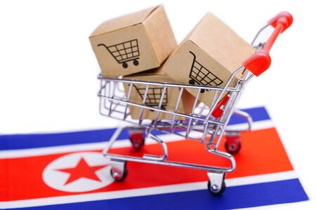 Box with shopping cart logo and North Korea flag : Import Export Shopping online or eCommerce delivery service store product shipping, trade, supplier concept.