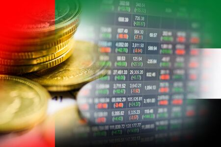 Stock market investment trading financial, coin and United Arab Emirates flag or Forex for analyze profit finance business trend data background.