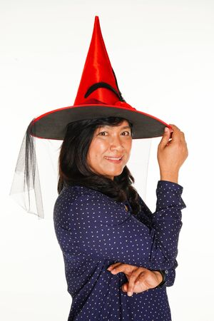 Asian women with Halloween red hat on white background.