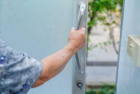 Asian senior or elderly old lady woman patient use toilet bathroom handle security in nursing hospital ward : healthy strong medical concept. Archivio Fotografico