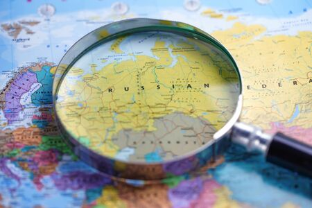 Magnifying glass close up with colorful map