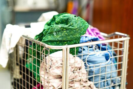 The used cloth in basket prepare to wash at home : Laundry concept. Stock Photo