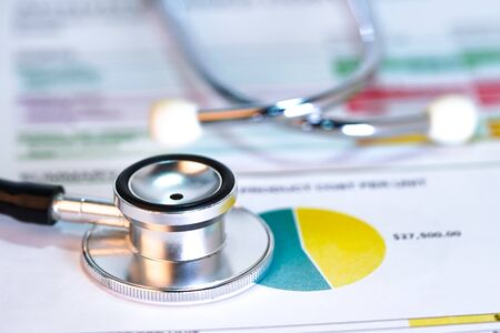 Stethoscope on chart graph paper : finance, account, statistic, analytic economy Business concept.financial,stethoscope,graph,health