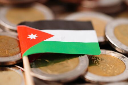 Jordan flag on coins background : Business and finance concept.