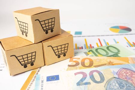 Shopping cart  at box on graph background. Banking Account, Investment Analytic research data economy, trading, Business import export transportation online company concept. Standard-Bild