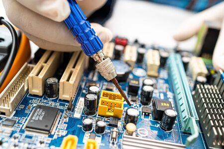 technician repairing inside of hard disk by soldering iron. Integrated Circuit. the concept of data, hardware, technician and technology. Standard-Bild