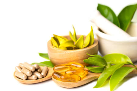 Alternative medicine herbal organic capsule with vitamin E omega 3 fish oil, mineral, drug with herbs leaf natural supplements for healthy good life.
