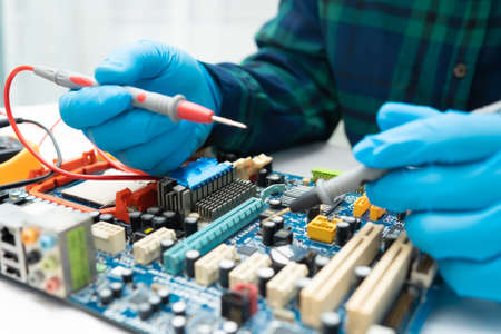 Asian Technician repairing micro circuit main board computer electronic technology, hardware, mobile phone, upgrade, cleaning concept.