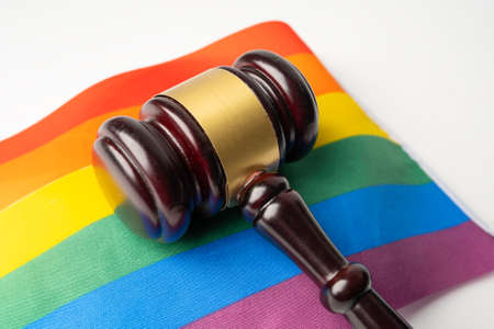 Gavel for judge lawyer on rainbow flag, symbol of LGBT pride month celebrate annual in June social of gay, lesbian, bisexual, transgender, human rights. Standard-Bild