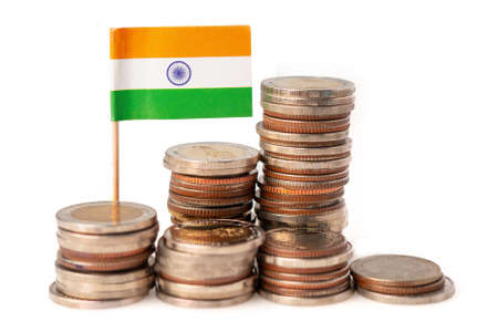 Stack of coins with India flag on white background.