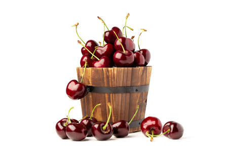 Berry Cherry in wooden round barrel pot on white background.