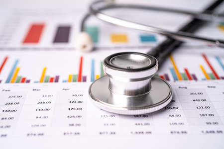 Stethoscope on chart graph paper, finance, account, statistic, analytic economy Business concept.