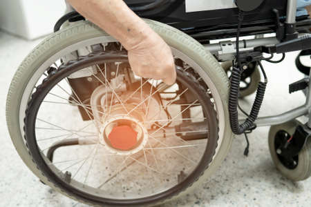 Asian senior or elderly old lady woman patient on electric wheelchair with remote control at nursing hospital ward, healthy strong medical concept